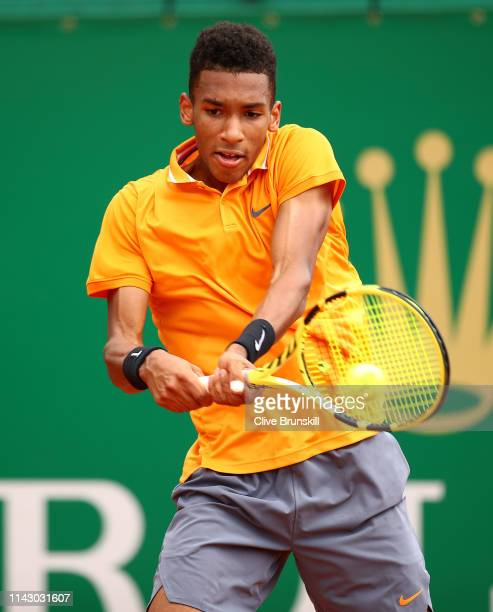 Felix AugerAliassime of Canada plays a backhand against Juan Ignacio Londero of Argentina in their first round match during day 3 of the Rolex...