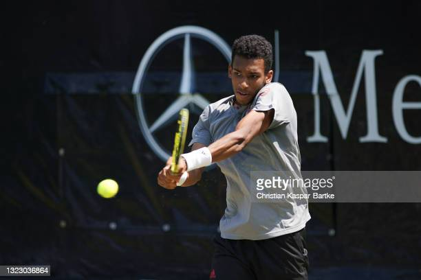 Felix Auger-Aliassime of Canada plays a backhand during his match against Ugo Humbert of France during day 5 of the MercedesCup at Tennisclub...