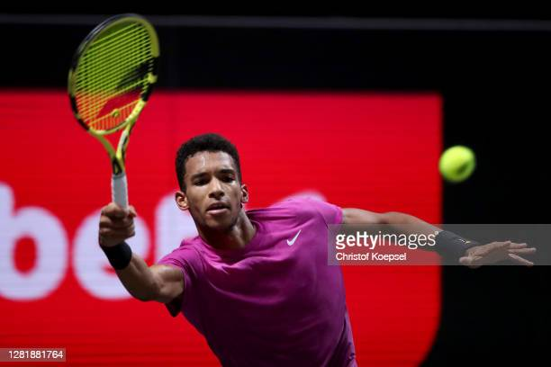 Felix Auger-Aliassime of Canada plays a backhand during the match between Yoshihito Nishioka of Japan and Felix Auger-Aliassime of Canada of day five...