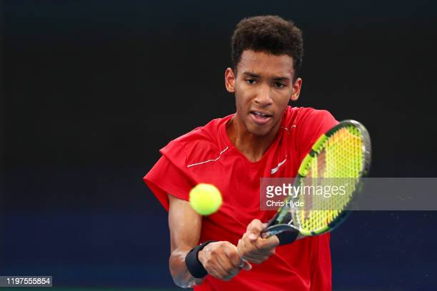 Felix AugerAliassime of Canada plays a backhand in his match against John Millman of Australia during day three of the 2020 ATP Cup Group Stage at...