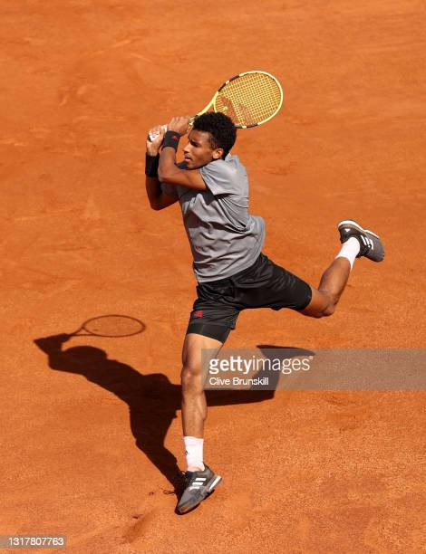 Felix Auger-Aliassime of Canada plays a backhand in their mens singles third round match against Federico Delbonis of Argentina during Day Six of the...