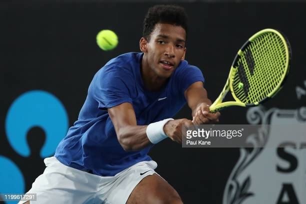 Felix Auger-Aliassime of Canada plays a backhand to James Duckworth of Australia during day four of the 2020 Adelaide International at Memorial Drive...