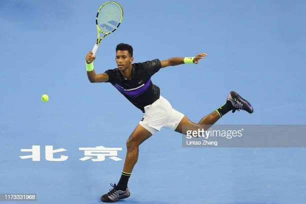 Felix AugerAliassime of Canada plays a forehand against Alexander Zverev of Germany during the Men's singles second round of 2019 China Open at the...