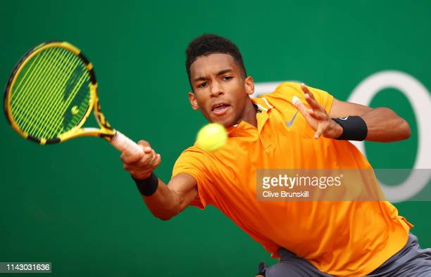 Felix AugerAliassime of Canada plays a forehand against Juan Ignacio Londero of Argentina in their first round match during day 3 of the Rolex...