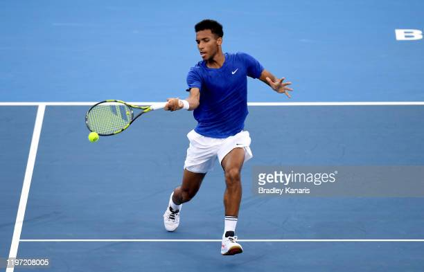 Felix AugerAliassime of Canada plays a forehand against Michail Pervolarakis of Greece during day one of the 2020 ATP Cup Group Stage at Pat Rafter...