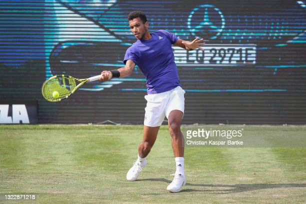 Felix Auger-Aliassime of Canada plays a forehand during his match against Lloyd Harris of South Africa during day 4 of the MercedesCup at Tennisclub...
