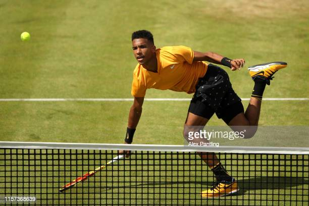Felix AugerAliassime of Canada plays a forehand during his QuarterFinal Singles Match against Stefanos Tsitsipas of Greece during day Five of the...