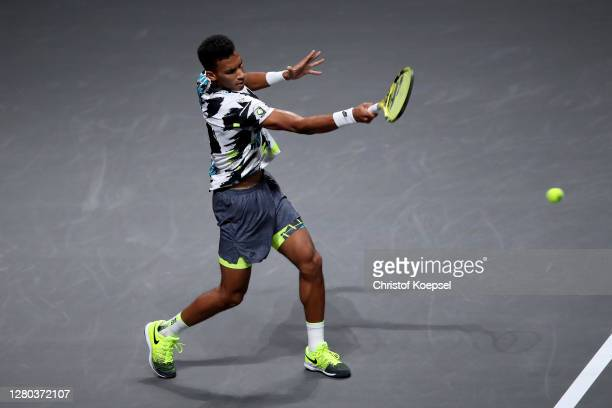 Felix Auger-Aliassime of Canada plays a forehand during the match between Henri Laaksonen of Switzerland and Felix Auger-Aliassime of Canada of day...