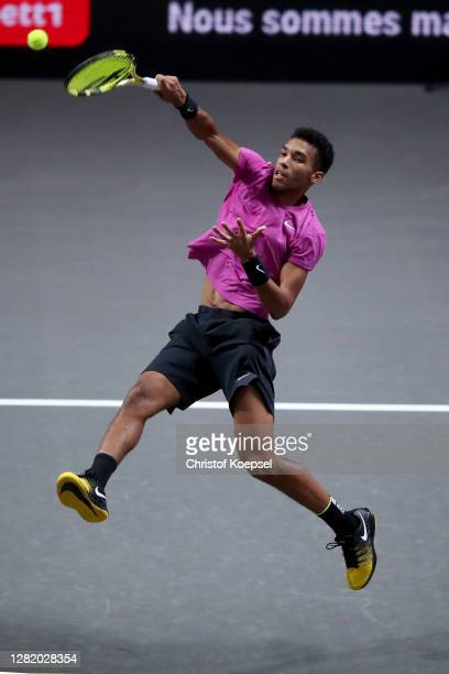 Felix Auger-Aliassime of Canada plays a forehand during the semi final match between Felix Auger-Aliassime of Canada and Diego Schwartzman of...