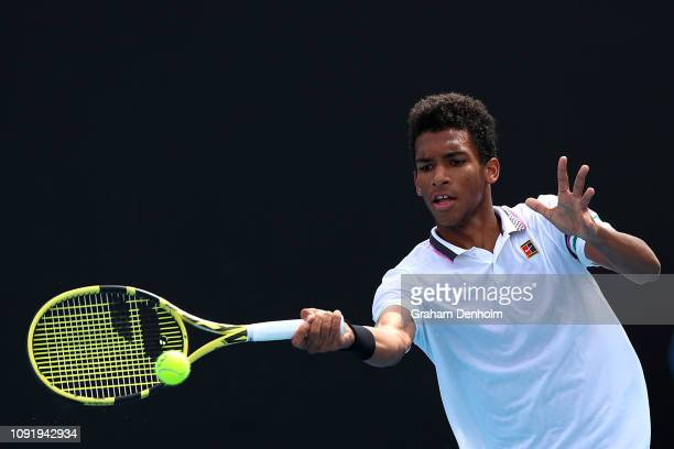 Felix AugerAliassime of Canada plays a forehand in his match against Christopher Eubanks of the United States during day three of Qualifying ahead of...