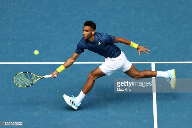 Felix Auger-Aliassime of Canada plays a forehand in his Men's Singles fourth round match against Aslan Karatsev of Russia during day seven of the...