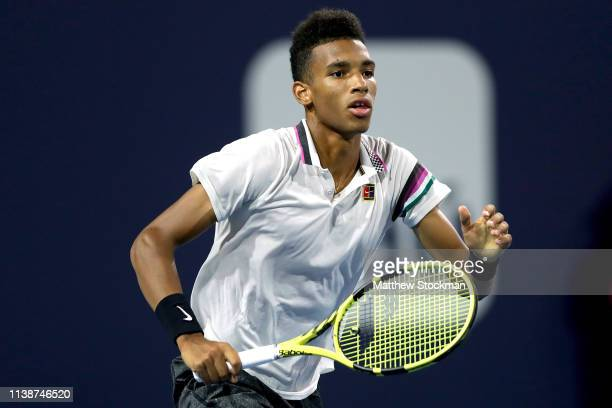 Felix AugerAliassime of Canada plays Borna Coric of Croatia during the Miami Open Presented by Itau at Hard Rock Stadium March 27 2019 in Miami...