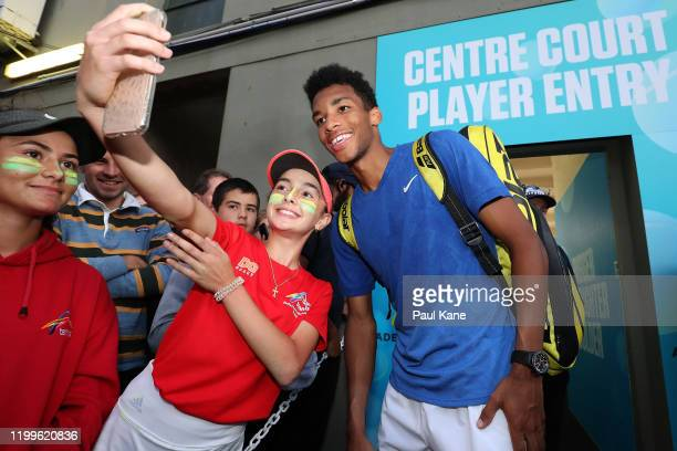 Felix AugerAliassime of Canada poses for selfies with after winning his singles match against James Duckworth of Australia during day four of the...