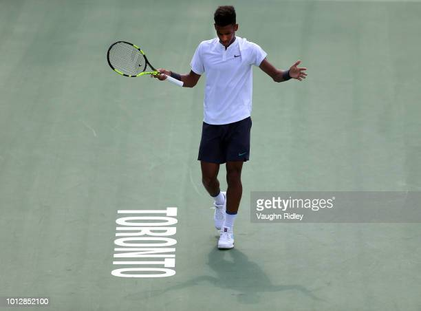 Felix AugerAliassime of Canada reacts after a missed shot against Lucas Pouille of France during a 1st round match on Day 2 of the Rogers Cup at...