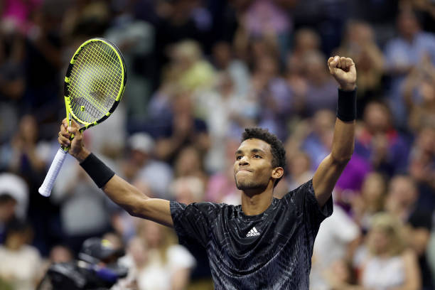 Felix Auger-Aliassime of Canada reacts after winning against Frances Tiafoe of the United States during his Men's Singles round of 16 match on Day...