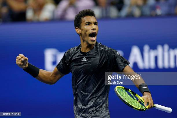 Felix Auger-Aliassime of Canada reacts against Carlos Alcaraz of Spain during his Men's Singles quarterfinals match on Day Nine of the 2021 US Open...