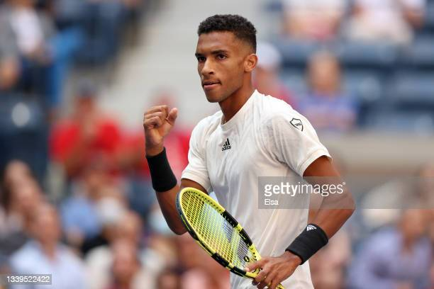 Felix Auger-Aliassime of Canada reacts against Daniil Medvedev of Russia during their Men's Single semifinal match on Day Twelve of the 2021 US Open...