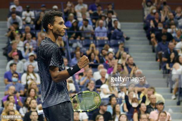 Felix Auger-Aliassime of Canada reacts to winning match point against Frances Tiafoe of the United States during his Men's Singles round of 16 match...