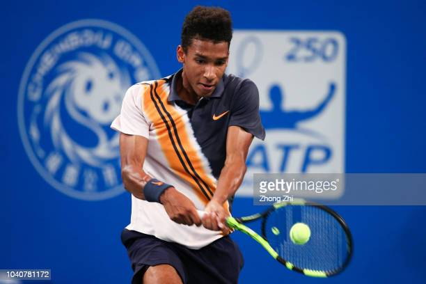 Felix AugerAliassime of Canada returns a shot against Chung Hyeon of Korea during 2018 ATP World Tour Chengdu Open at Sichuan International Tennis...