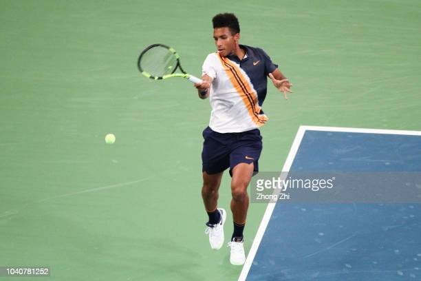Felix AugerAliassime of Canada returns a shot against Chung Hyeon of Korea during 2018 ATP World Tour Chengdu Open at Sichuan International Tennis...