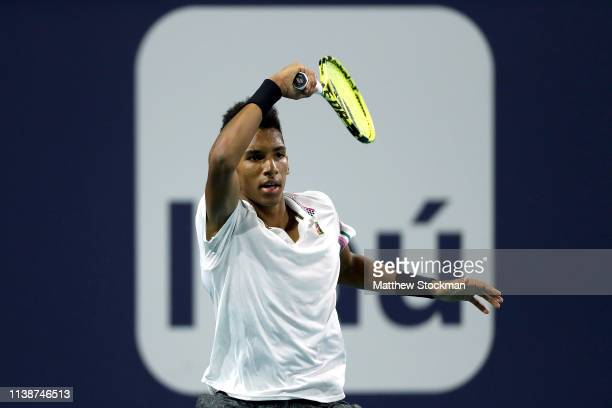 Felix AugerAliassime of Canada returns a shot to Borna Coric of Croatia during the Miami Open Presented by Itau at Hard Rock Stadium March 27 2019 in...