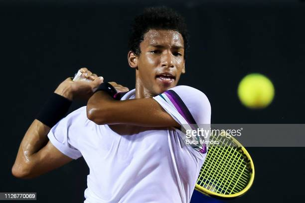 Felix AugerAliassime of Canada returns a shot to Jaume Munar of Spain during the ATP Rio Open 2019 at Jockey Club Brasileiro on February 22 2019 in...