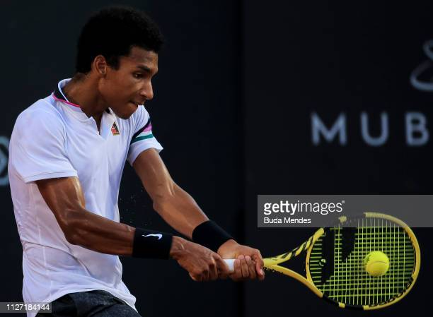 Felix AugerAliassime of Canada returns a shot to Laslo Djere of Serbia during the singles final of the ATP Rio Open 2019 at Jockey Club Brasileiro on...