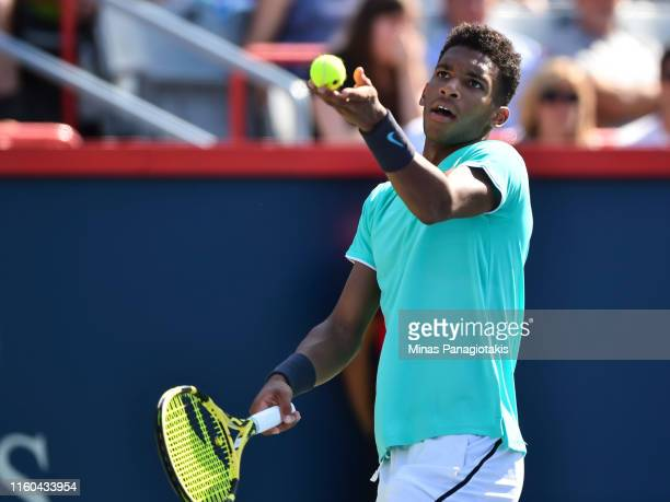 Felix AugerAliassime of Canada serves against Karen Khachanov of Russia during day 7 of the Rogers Cup at IGA Stadium on August 8 2019 in Montreal...