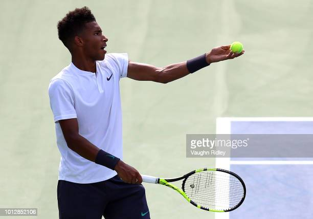 Felix AugerAliassime of Canada serves against Lucas Pouille of France during a 1st round match on Day 2 of the Rogers Cup at Aviva Centre on August 7...