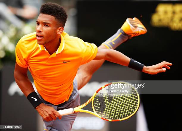 Felix AugerAliassime of Canada serves during his first round match agains Borna Coric of Croatia during day two of the International BNL d'Italia at...