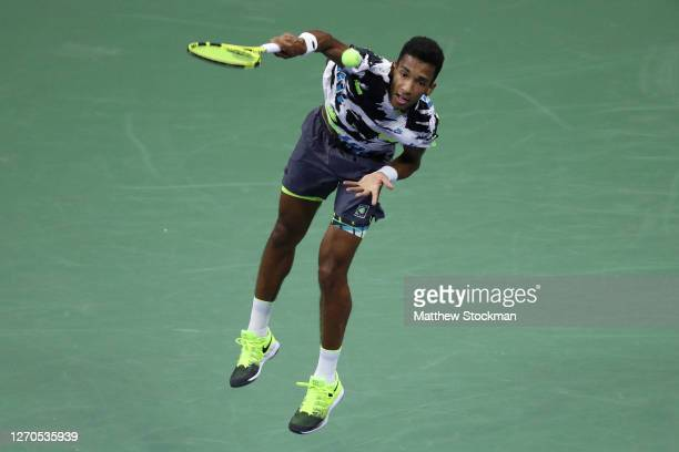 Felix Auger-Aliassime of Canada serves during his Men's Singles second round match against Andy Murray of Great Britain on Day Four of the 2020 US...