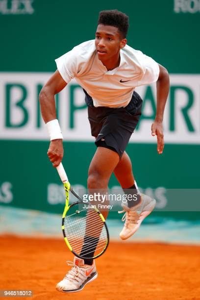 Felix AugerAliassime of Canada serves during the Round of 64 match between Mischa Zverev and Felix AugerAliassime during Day One of ATP Masters...