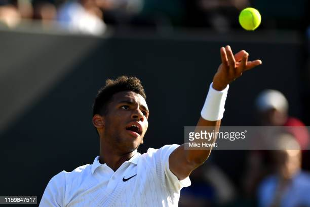Felix AugerAliassime of Canada serves in his Men's Singles second round match against Corentin Moutet of France during Day three of The Championships...