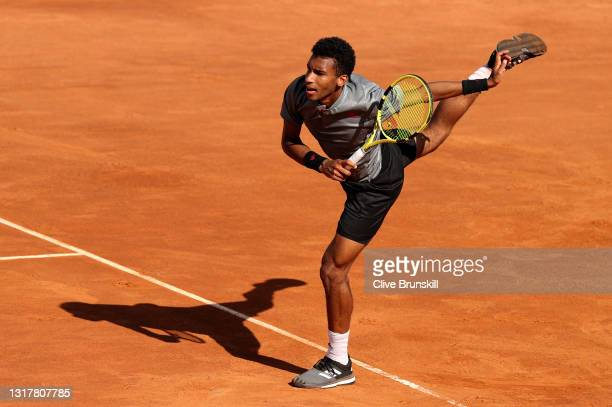 Felix Auger-Aliassime of Canada serves in their mens singles third round match against Federico Delbonis of Argentina during Day Six of the...