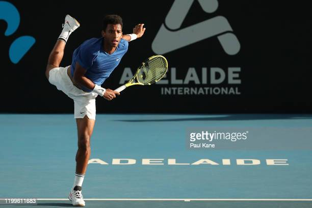 Felix AugerAliassime of Canada serves to James Duckworth of Australia during day four of the 2020 Adelaide International at Memorial Drive on January...