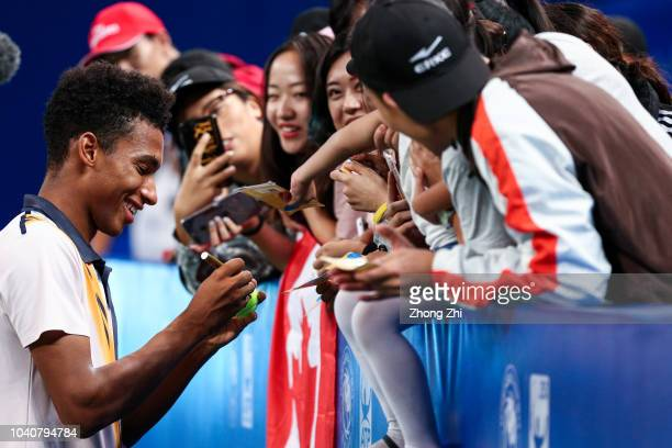 Felix AugerAliassime of Canada signs autograph for fans after winning over Chung Hyeon of Korea during 2018 ATP World Tour Chengdu Open at Sichuan...