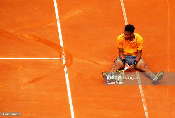 Felix AugerAliassime of Canada takes a breather after slipping during his first round match agains Borna Coric of Croatia during day two of the...