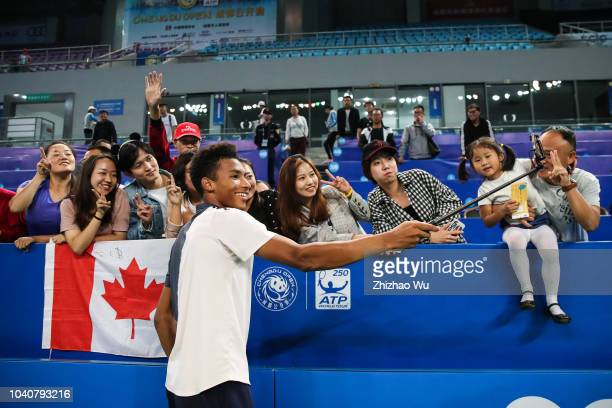 Felix AugerAliassime of Canada takes a selfie with fans after a match against Chung Hyeon of South Korea during ATP World Tour Chengdu Open 2nd Round...