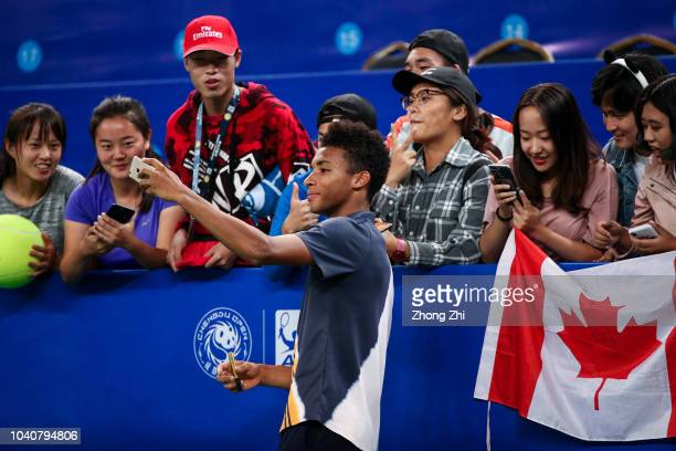 Felix AugerAliassime of Canada takes selfie with fans after winning over Chung Hyeon of Korea during 2018 ATP World Tour Chengdu Open at Sichuan...