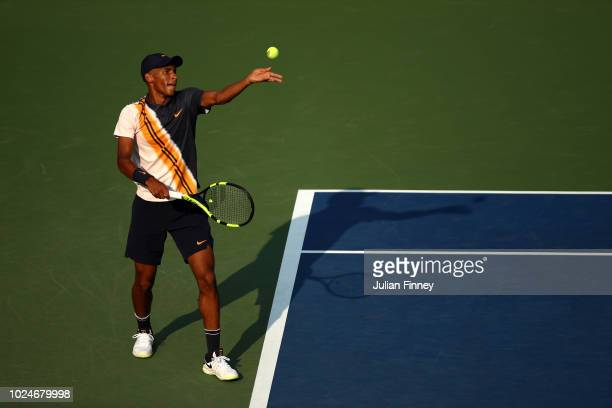 Felix AugerAliassime of Canda serves the ball during his men's singles first round match against Denis Shapovalov of Canada on Day One of the 2018 US...