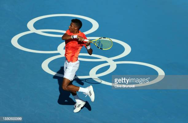 Felix Auger-Aliassime of Team Canada plays a forehand during his Men's Singles First Round match against Max Purcell of Australia on day two of the...