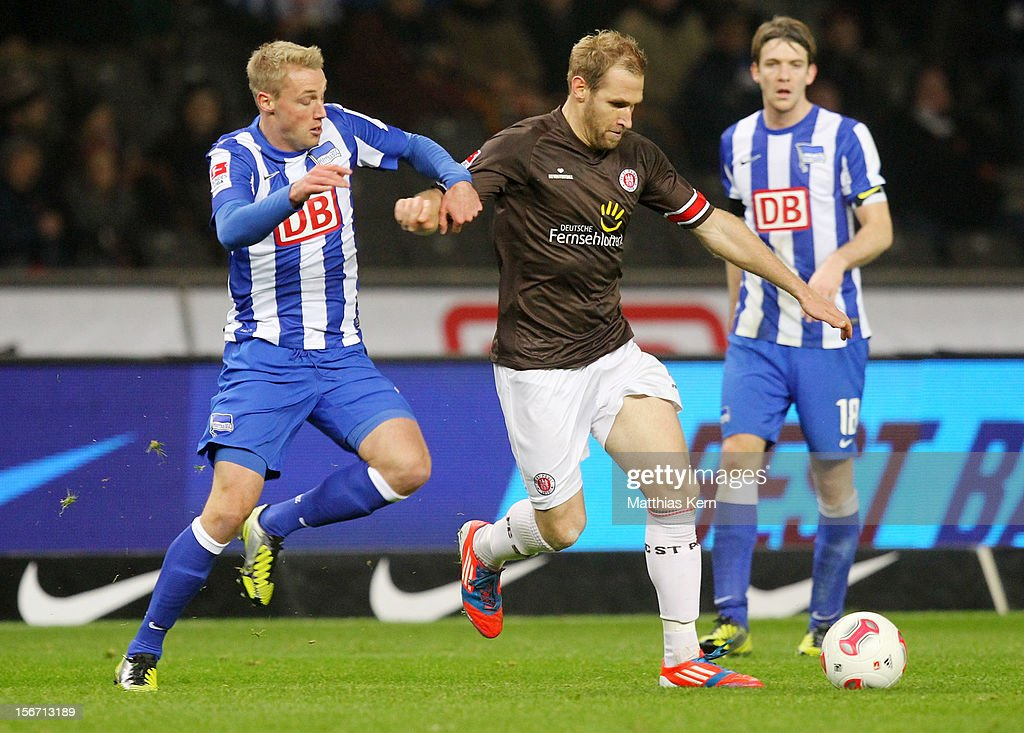 Felix Bastians (L) of Berlin battles for the ball with Florian Kringe (R) of St. Pauli during the Second Bundesliga match between Hertha BSC Berlin and FC St. Pauli at Olympic stadium on November 19, 2012 in Berlin, Germany.