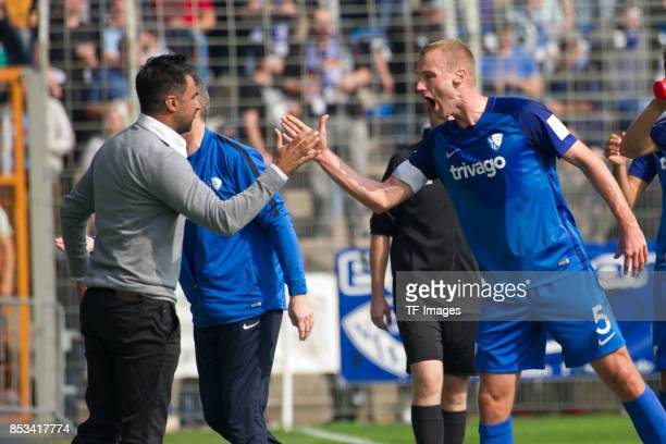 Felix Bastians of Bochum celebrates after scoring his team`s first goal with Head coach Ismail Atalan of Bochum during the Second Bundesliga match...