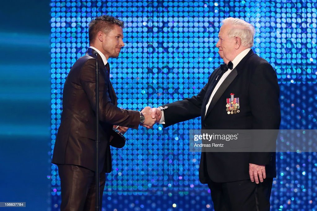 Felix Baumgartner receives the 'Millennium' Bambi from Joe Kittinger during the 'BAMBI Awards 2012' at the Stadthalle Duesseldorf on November 22, 2012 in Duesseldorf, Germany.