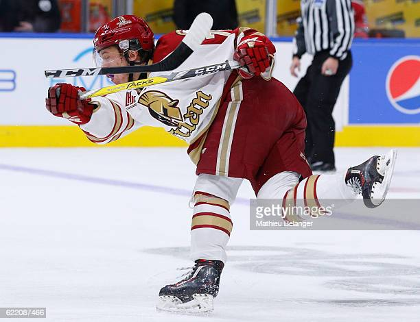 Felix Boivin of the Acadie-Bathurst Titan breaks his stick as he makes a shot against the Quebec Remparts during their QMJHL hockey game at the...