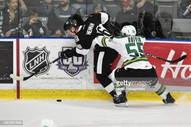 Felix Boivin of the ValdOr Foreurs pins Luke Henman of the BlainvilleBoisbriand Armada against the boards during the QMJHL game at Centre...