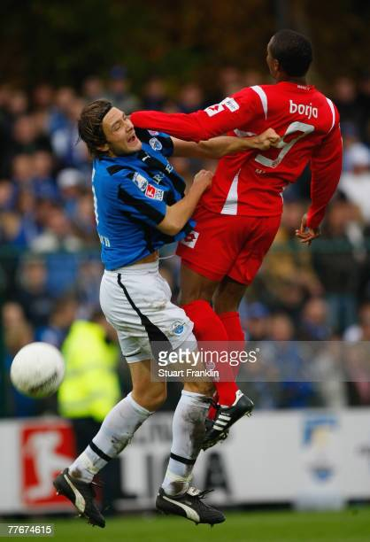 Felix Borja of Mainz is challenged by Nils Doring of Paderborn during the 2nd Bundesliga match between SC Paderborn and FSV Mainz 05 at the...