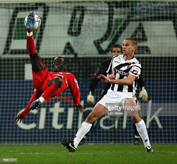 Felix Borja of Mainz makes an overhead kick next to Filip Daems of Moenchengladbach during the 2nd Bundesliga match between Borussia Moenchengladbach...