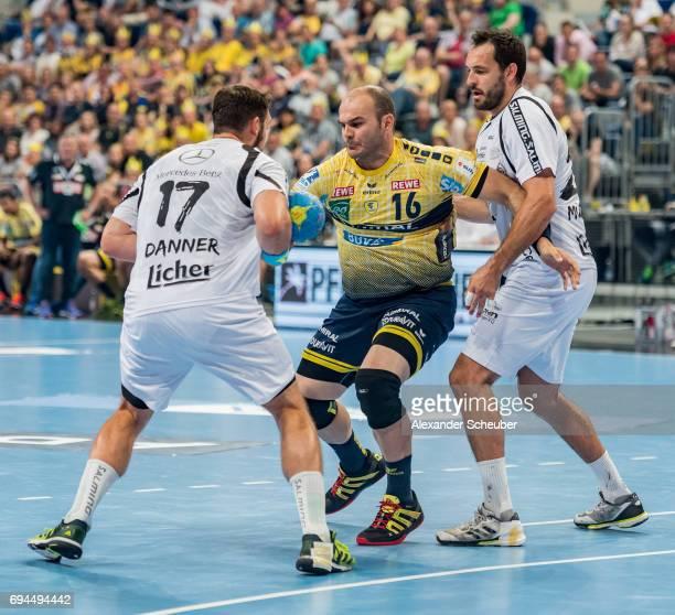 Felix Danner of Melsungen challenges Rafael Baena Gonzalez of Rhein Neckar Loewen during the DKB HBL match between Rhein Neckar Loewen and MT...