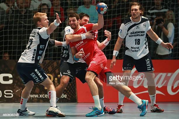 Felix Danner of Melsungen is challenged by Anders Zachariassen Tobias Karlsson and Lars Kaufmann of FlensburgHandewitt during the DKB Handball...